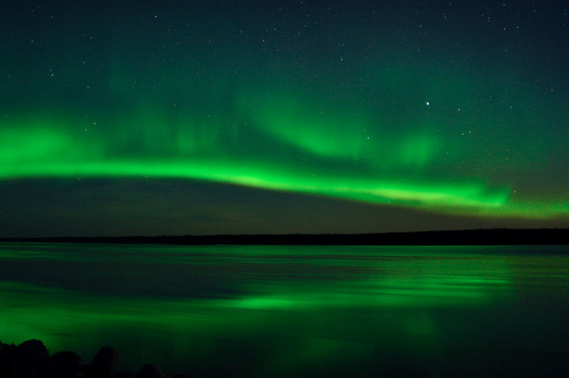 Northern lights reflected in a canadian river