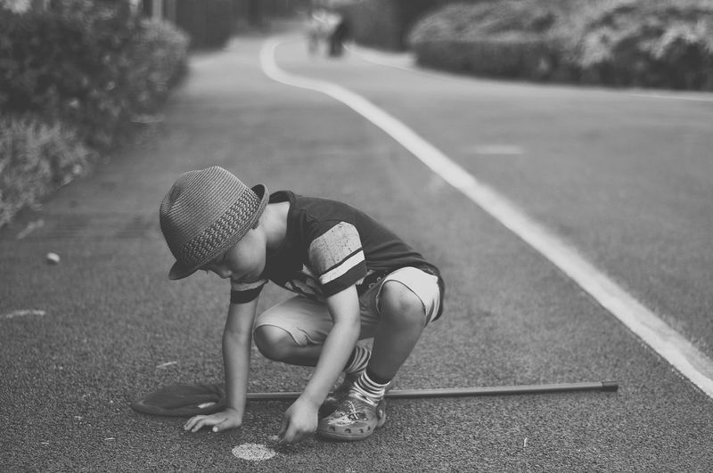 Boy Playing On Road
