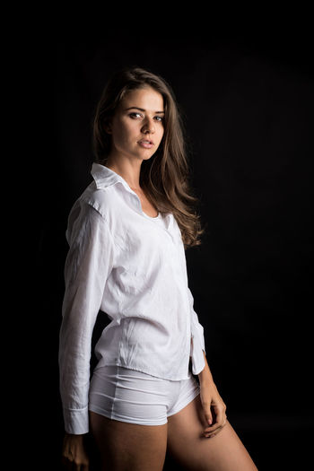 One Person Young Women Beauty Young Adult Beautiful Woman Studio Shot Women Three Quarter Length Looking At Camera Portrait Hair Hairstyle Black Background Long Hair Adult Indoors  Clothing Fashion Contemplation