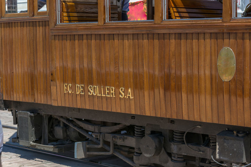 Lettering the vintage train, tram on the beach promenade of the town of Soller in Spain. Architecture Balearics Built Structure Day Destinationweddingphotographer Historic Railroad Majorca No People Outdoors Railroad Car Sierra De Tramuntana Text
