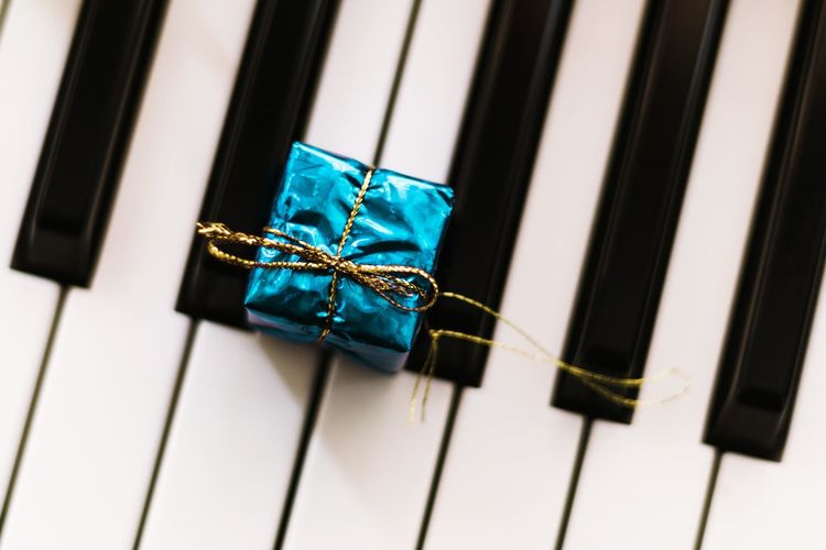 Directly above shot of small gift box on piano