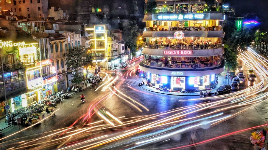 Sleepless in Hanoi Eyeemphotography City View Cafe Hanoi Vietnamphotography Vietnam Streetphotography Night City Illuminated Architecture Building Exterior Transportation Built Structure Light Trail Road Street Motion Long Exposure Speed City Street Mode Of Transportation Blurred Motion City Life Traffic