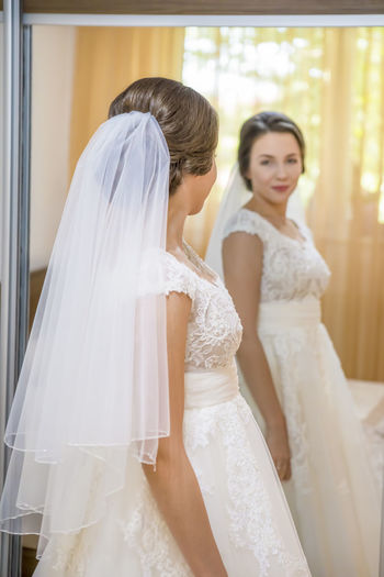 Bride Looking In Mirror At Home
