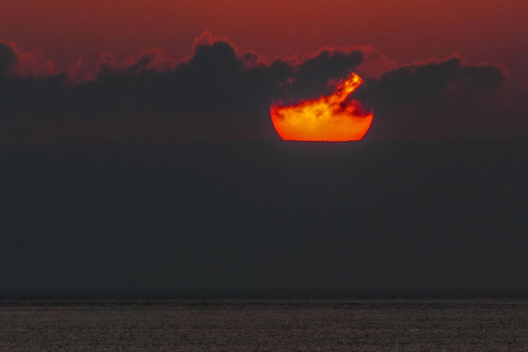 Sky Nature Beauty In Nature Cloud - Sky Environment Sunset Scenics - Nature Night Heat - Temperature No People Water Outdoors Sea Lava Warning Sign Burning Accidents And Disasters Sign Land Orange Color Power In Nature