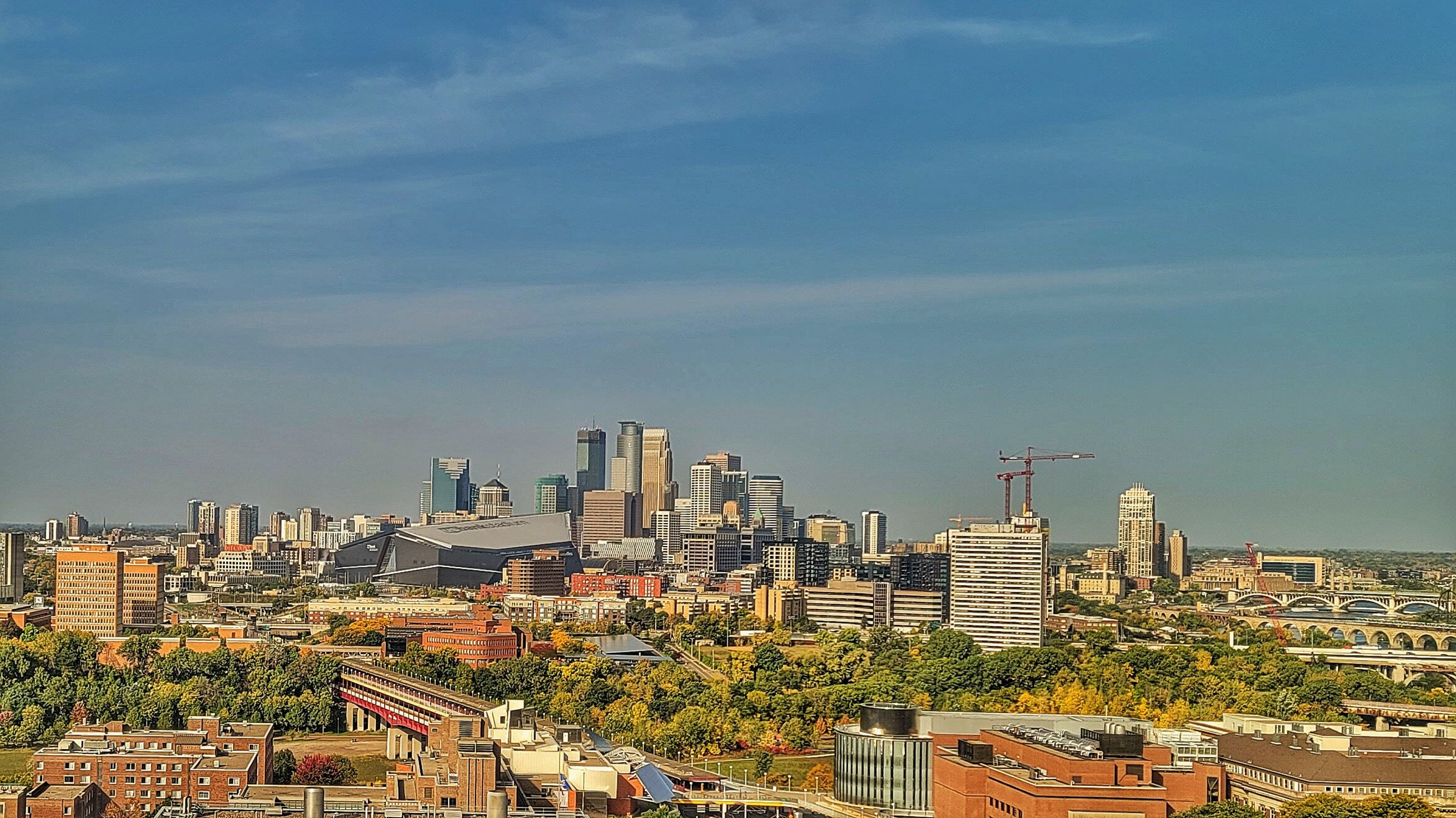architecture, city, building exterior, built structure, building, cityscape, skyline, sky, horizon, urban area, office building exterior, urban skyline, landscape, skyscraper, residential district, metropolitan area, downtown, nature, high angle view, travel destinations, no people, city life, metropolis, outdoors, aerial photography, residential area, cloud, tower, downtown district, landmark, travel, neighbourhood, day, office, tower block, development, dusk