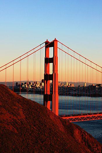 View of suspension bridge against sky during sunset