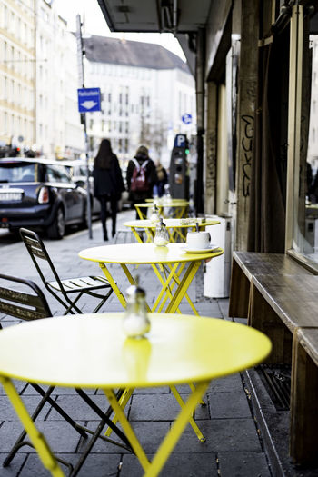 Tables And Chairs Arranging At Sidewalk Cafe