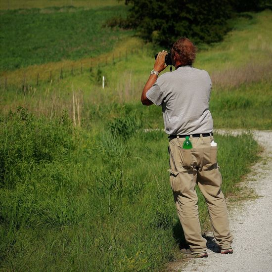 Male photographer Iowa summer 2017 Activity Adult Canon Canonphotography Casual Clothing Day Field Full Length Grass Green Color Land Leisure Activity Men Nature One Person Outdoors Photography Themes Plant Real People Rear View Standing Summer Technology