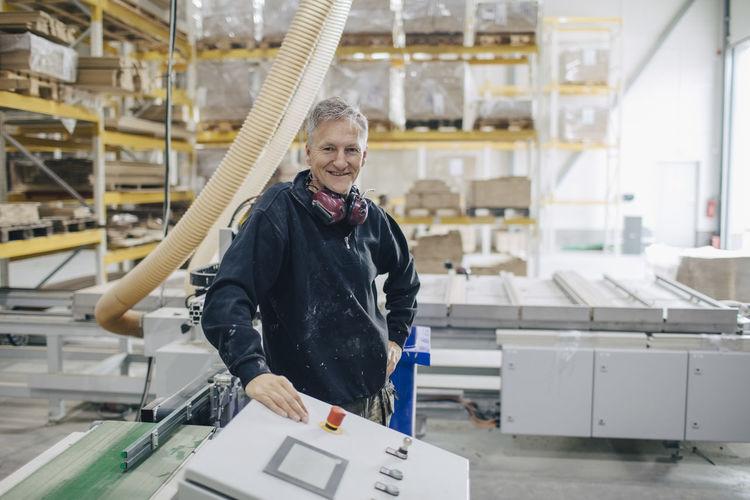 Portrait of senior man working in factory