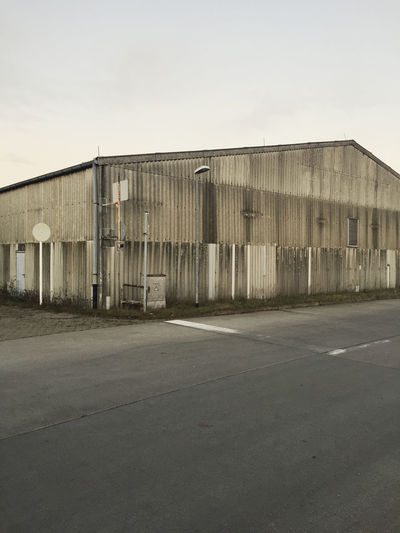 Abandoned Aged Alone Architecture Building Exterior Built Structure Day Factory Greyscale Industrial Industry No People Old Old Buildings Outdoors Sky Traces Warehouse Wine Cask Worn Out