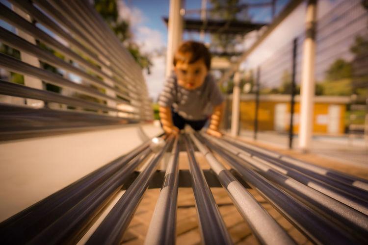 Cute boy playing on bench