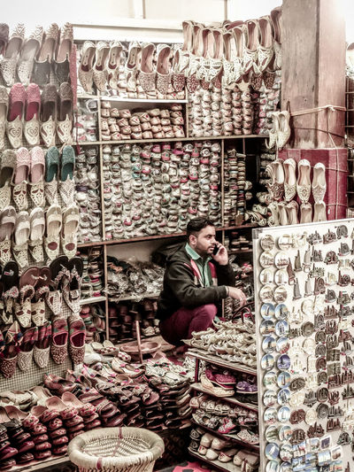 Adult Adults Only Business Business Finance And Industry Businessman Choice Counting Day Examining Large Group Of Objects Men Occupation One Man Only One Person Owner People Retail  Sale Sales Occupation Shoe Shop Shoes Shoes ♥ Small Business Store Variation The Street Photographer - 2017 EyeEm Awards