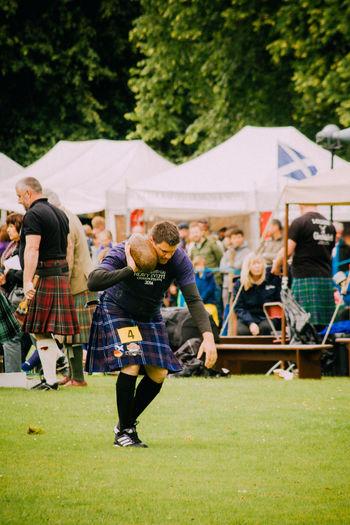 Fun Highland Games Kilt Leisure Activity Lifestyles Men Real People Scotland Standing Stone Put