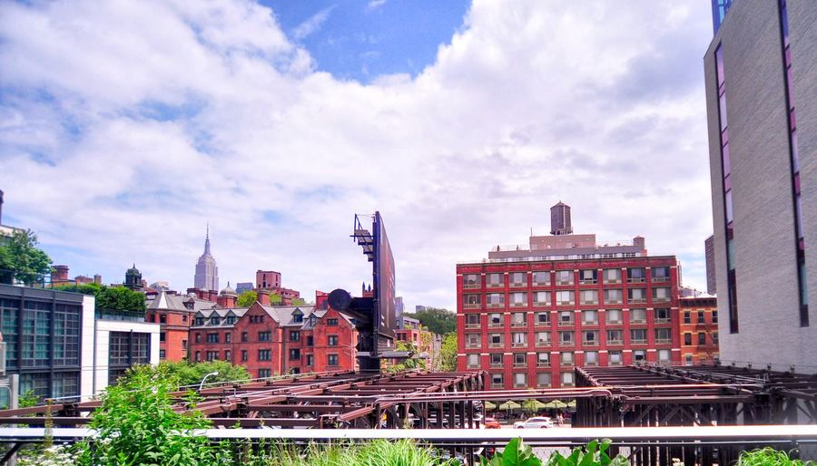 Architecture Building Exterior Built Structure City Sky Cloud - Sky Outdoors Day Cityscape Skyscraper One Person People Urban Geometry Rooftop High Line Park NYC NYC Street Photography Urbanphotography Sunny