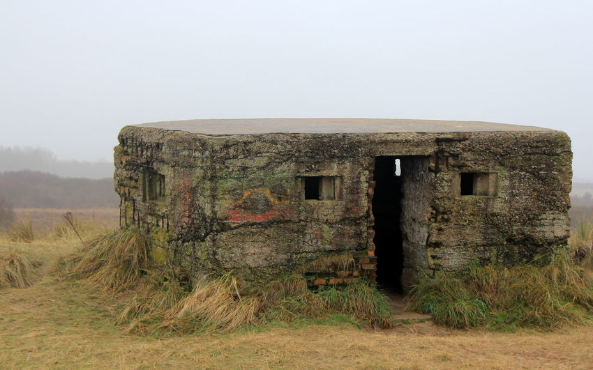 Abandoned Arid Climate Bad Condition Beach Damaged Day Defense No People Obsolete Old Ruin Outdoors PILLBOX Ruined Rural Scene Second World War Sky Spooky The Past War Weathered