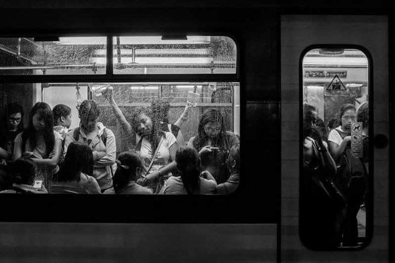The railway system in the country separates women, children, and elderlies from the regular coaches occupied mostly by men, for the reason of convenience, safety and security. | Railway Philippine Metro Rail EyeEm Best Shots EyeEmBestPics Eyeem Philippines EyeEmbestshots Eye4photography  Commuter Train Train Black And White Commute Commuters Untold Stories The Human Condition Everybodystreet Everyday Life Everyday People Cities At Night Mrt Philippines Mrt Up Close Street Photography
