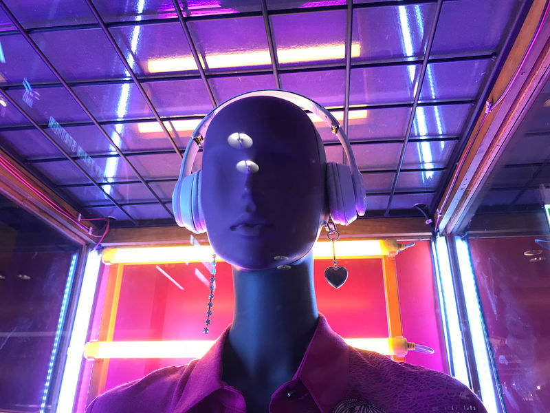 Indoors  Illuminated Headshot Lighting Equipment Portrait Lifestyles Mannequin Ceiling Representation Purple Built Structure Architecture Robot Electronic Bulbs Lighing Mall Indoors  Headphones Artificial Intelligence
