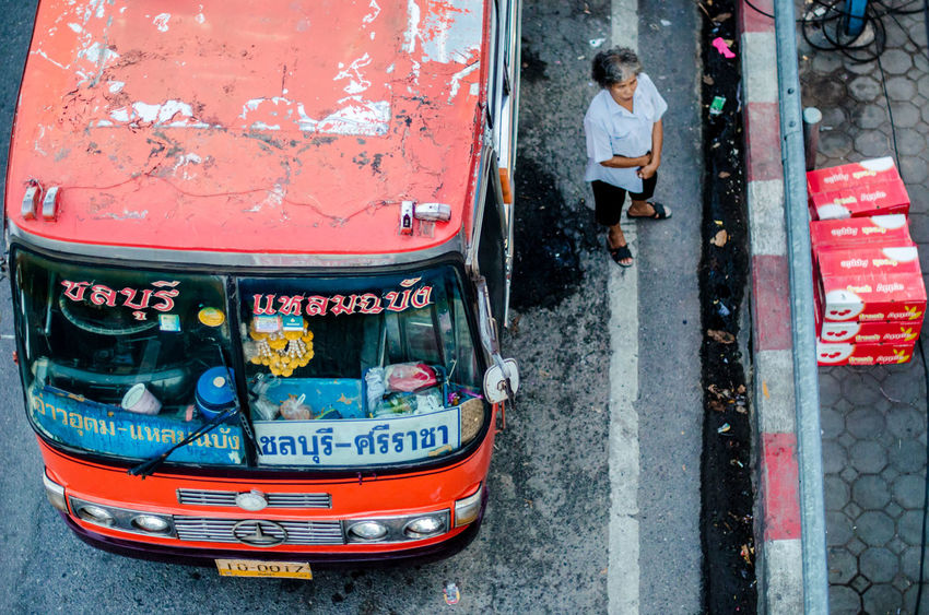 Vintage local bus with senior ticket taker Bus Chon Buri Information Local Bus Mode Of Transport Old Old Woman Omnibus Passenger Car Real People Red Road Senior Sign Street Street Photography Text Thailand Ticket Taker Top Views Transport Transportation Transportation Vintage Women