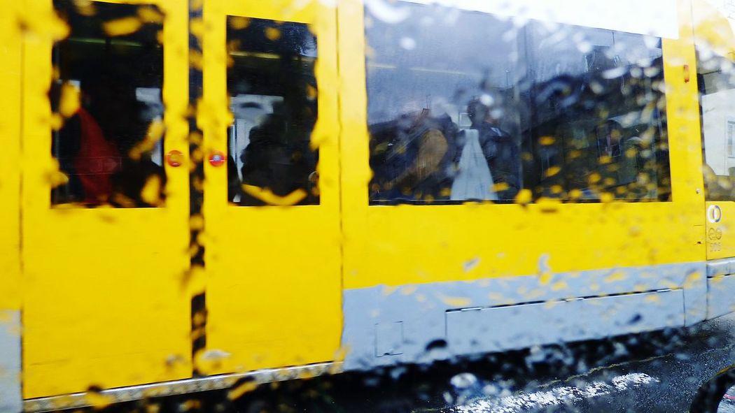 In a Rainy Day Taking Photos Inside My Car Public Transport the Yellow Train i am Looking Through Window Rain Rain Drops Rain Drops On The Window Transportation Public Transportation Tourist Bus City Explore City Explorer