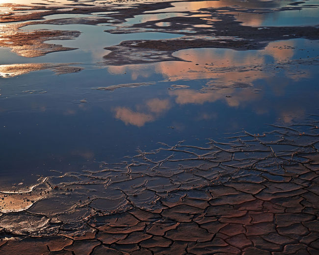 High angle view of reflection in puddle on lake