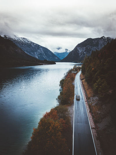 Drone  Drones Lakeview Beauty In Nature Day Drone Photography Dronephotography Droneshot Lake Lake View Lakeshore Lakeside Mountain Mountain Range Nature No People Outdoors Road Scenics Sky The Way Forward Tranquility Transportation Tree Water