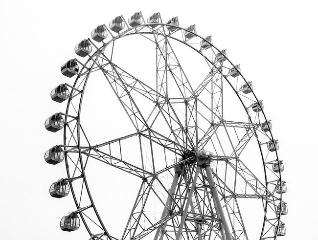 Wheel of Grey... Ferris Wheel No People Day Outdoors Amusement Park Black And White Structure Architecture Shades Grey Pattern Circle Star The Architect - 2017 EyeEm Awards