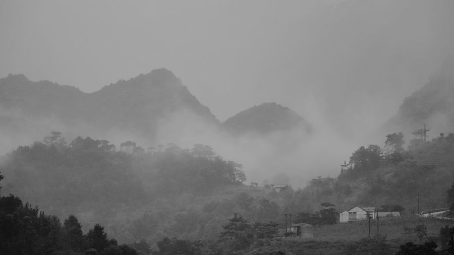 Hà Giang Misty Rainy Days Beauty In Nature Building Exterior Day Fog Foggy Hazy  Landscape Mist Mountain Mountain Peak Nature No People Outdoors Scenics Sky Tranquil Scene Tranquility