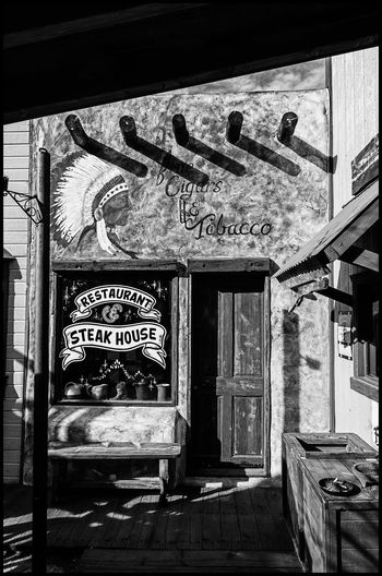 Things to See on Route 66, Williams, Arizona Text Architecture Built Structure Communication No People Western Script Building Exterior Graffiti Building Day Art And Craft Wall - Building Feature Sign Window Old Script Non-western Script Creativity Store Black And White Photography