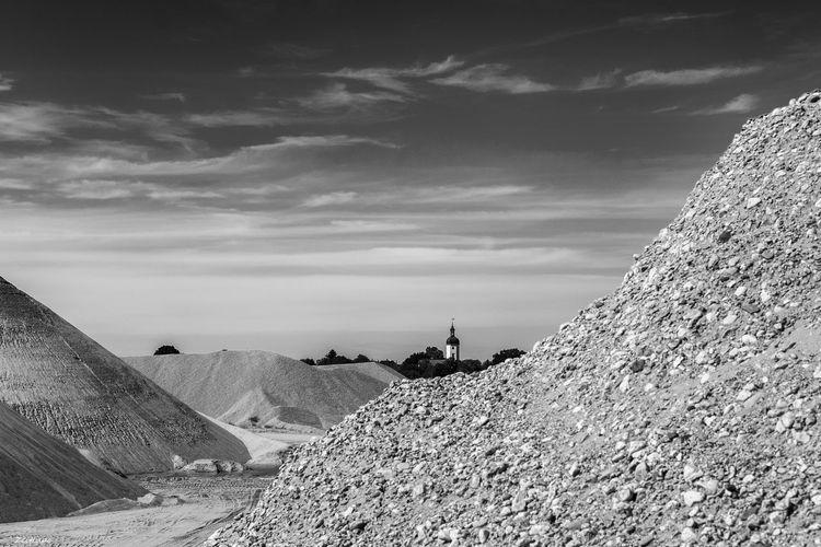 Heap of stones against sky