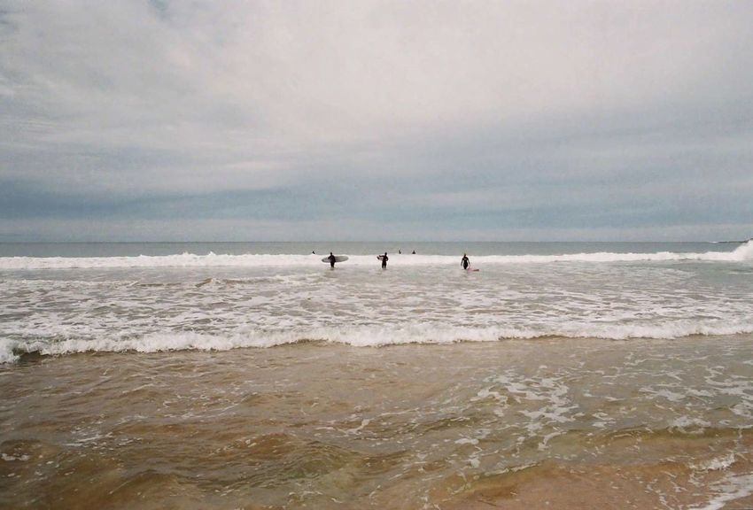 Stormy beach day. Analogue Photography Australia Cronullabeach EyeEmNewHere Beach Beauty In Nature Extreme Sports Film Photography Filmisnotdead Leisure Activity Nature Outdoors Sydney, Australia Real People Scenics Sea Sky Sport Standing Surfing Sydney Tranquility Vacations Water Wave