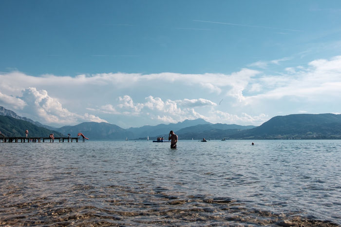 Attersee Austria Holiday Man Salzkammergut Summertime Swimming Beachday Beauty In Nature Clouds And Sky Crisp Day Lake Landscape Lush Model Mountain Mountain Range Nature Outdoors Scenics Sky Summer Water Young Adult