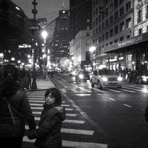 View of people walking on road at night