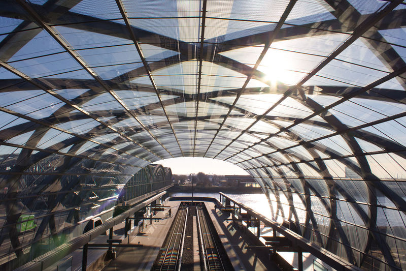 Architecture Rail Transportation Transportation Sunlight Built Structure Indoors  Travel Track Mode Of Transportation Railroad Track Public Transportation Day Arch Travel Destinations Metal Ceiling Nature Railroad Station No People Lens Flare Train Station