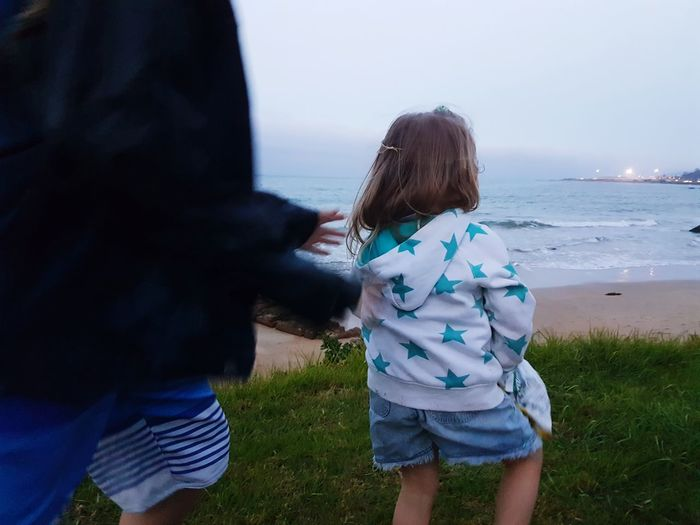 Big Brother Little Sister Motion Hands Catch Catching Brother Sister Wild Child Free Spirited Beach Evening Running Child Girl From Behind City Lights Boy Blue Children