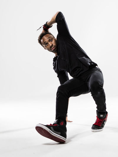 Breakdance Breakdancer Breakdancing Dance Day Full Length Hip Hop Leisure Activity Lifestyles One Person Outdoors People Real People Smiling Studio White Background Young Adult