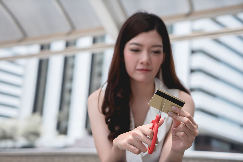 Female hands cutting credit card with scissors. Females Finances Lady Scissors Woman Bank Card Concept Credit Credit Card Cut Out Debit Debit Card Debt Debt Crisis Expense Finance Girl Hand Holding Lifestyles One Person People Problem Women
