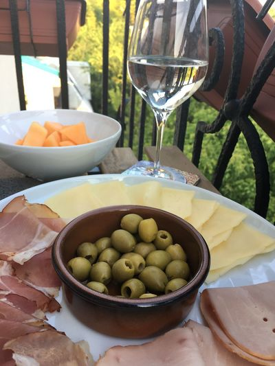 Green olives, melon and prosciutto on the table. Close up of mediterranean dinner. Cuisine Meal Mediterranean  Raw SLICE Snack Delicious Focus On Foreground Food Food And Drink Freshness Fruit Glass Gourmet Green Olive Healthy Healthy Eating Melon Olive Prosciutto Refreshment Table Tablecloth Wellbeing Wine