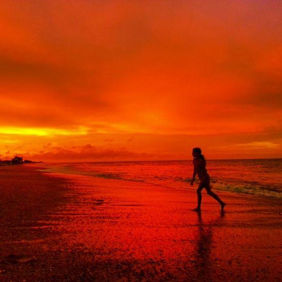 Orange Red Sunrise over OcracokeNorth Carolina Outer Banks, NC Girl Playing on the Beach Ocean EyeEm Best Shots EyeEm Nature Photooftheday