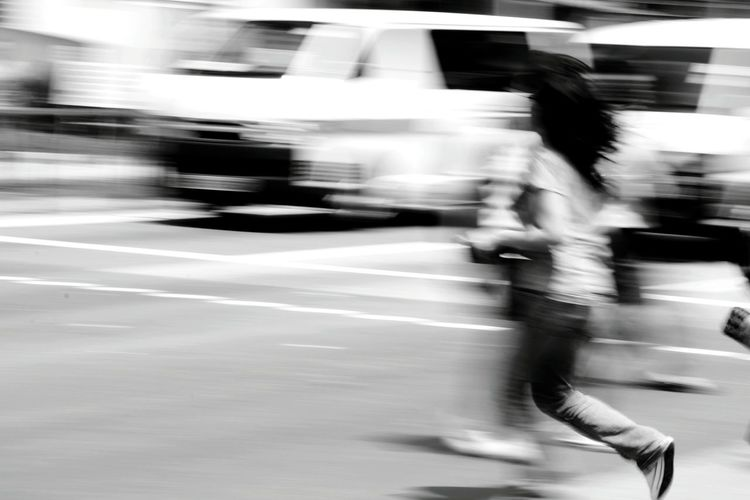 Blurred motion of people on road