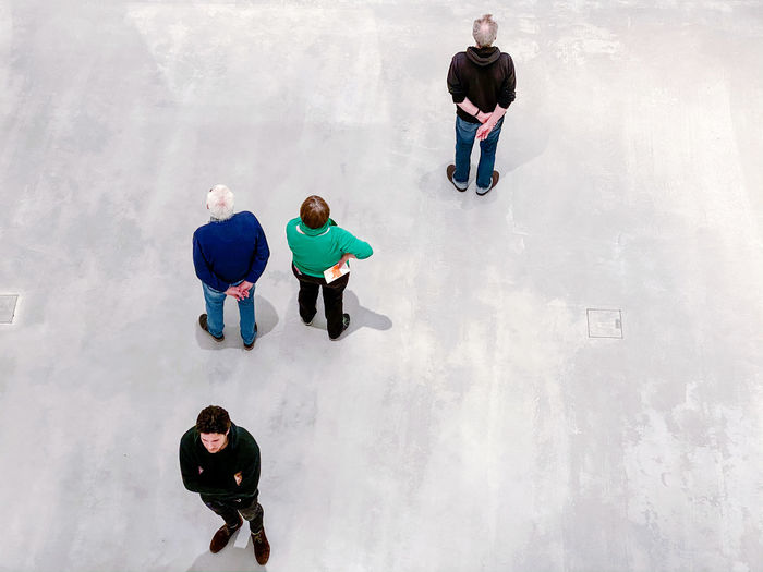 High angle view of people walking on friends
