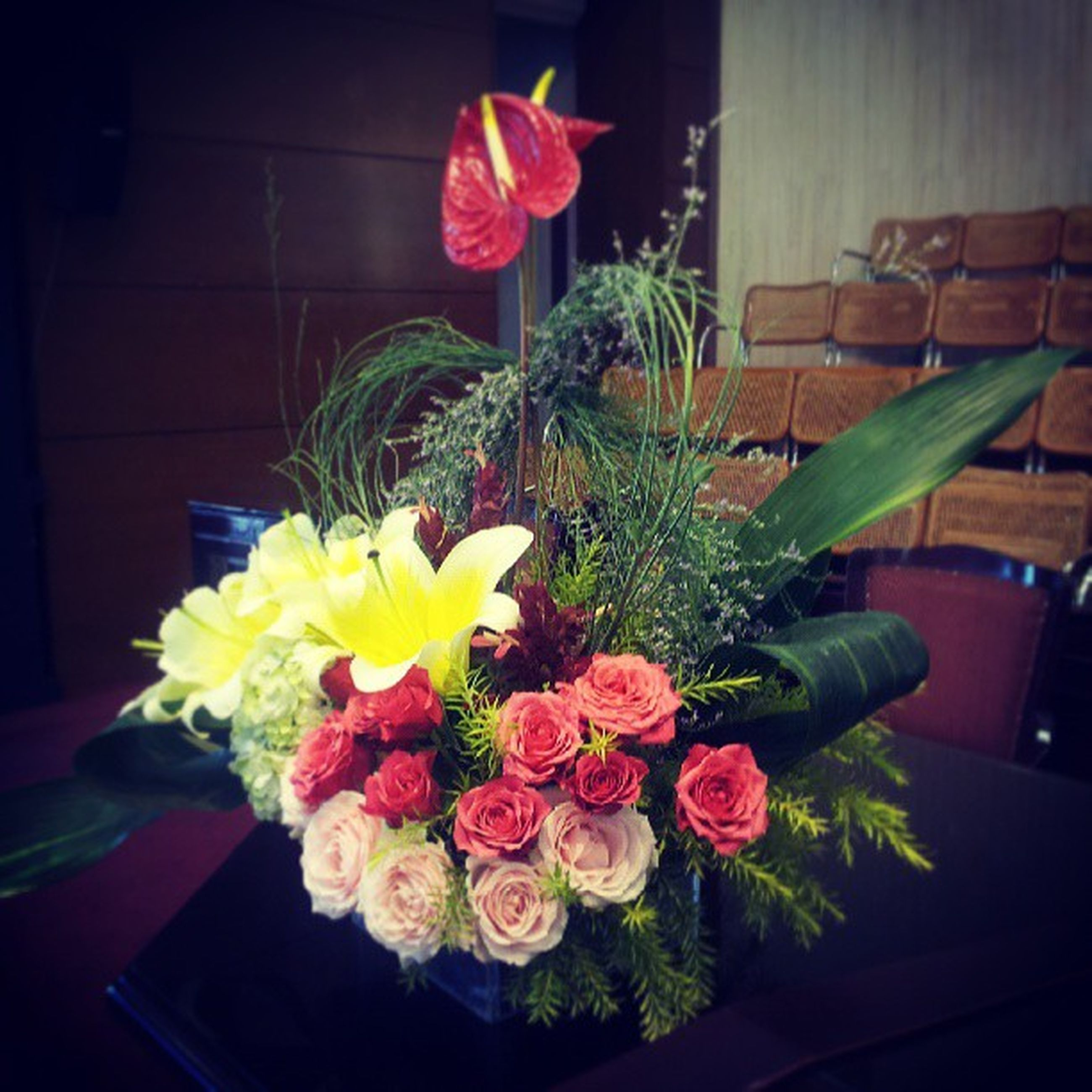 flower, indoors, freshness, petal, fragility, flower head, vase, flower arrangement, bouquet, home interior, table, decoration, potted plant, beauty in nature, plant, yellow, growth, rose - flower, bunch of flowers, close-up