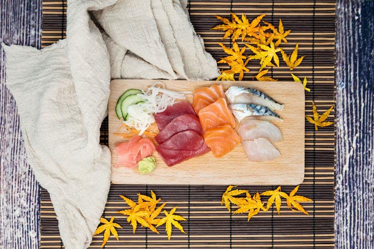 Directly above shot of sashimi on cutting board