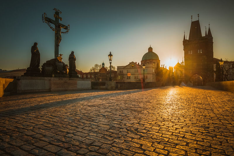 Architecture Bridge Building Exterior Built Structure City Clear Sky Cobblestone Dome History Illuminated Night No People Outdoors Place Of Worship Prague Religion Sculpture Sky Spirituality Statue Sunset Travel Destinations