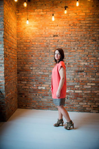 Dress International Women's Day Adult Adults Only Brick Wall Day Full Length Illuminated Indoors  Linen One Person Orange Color People Smile Smiling Standing Summer Fashion Summer Style Women Young Adult Young Women