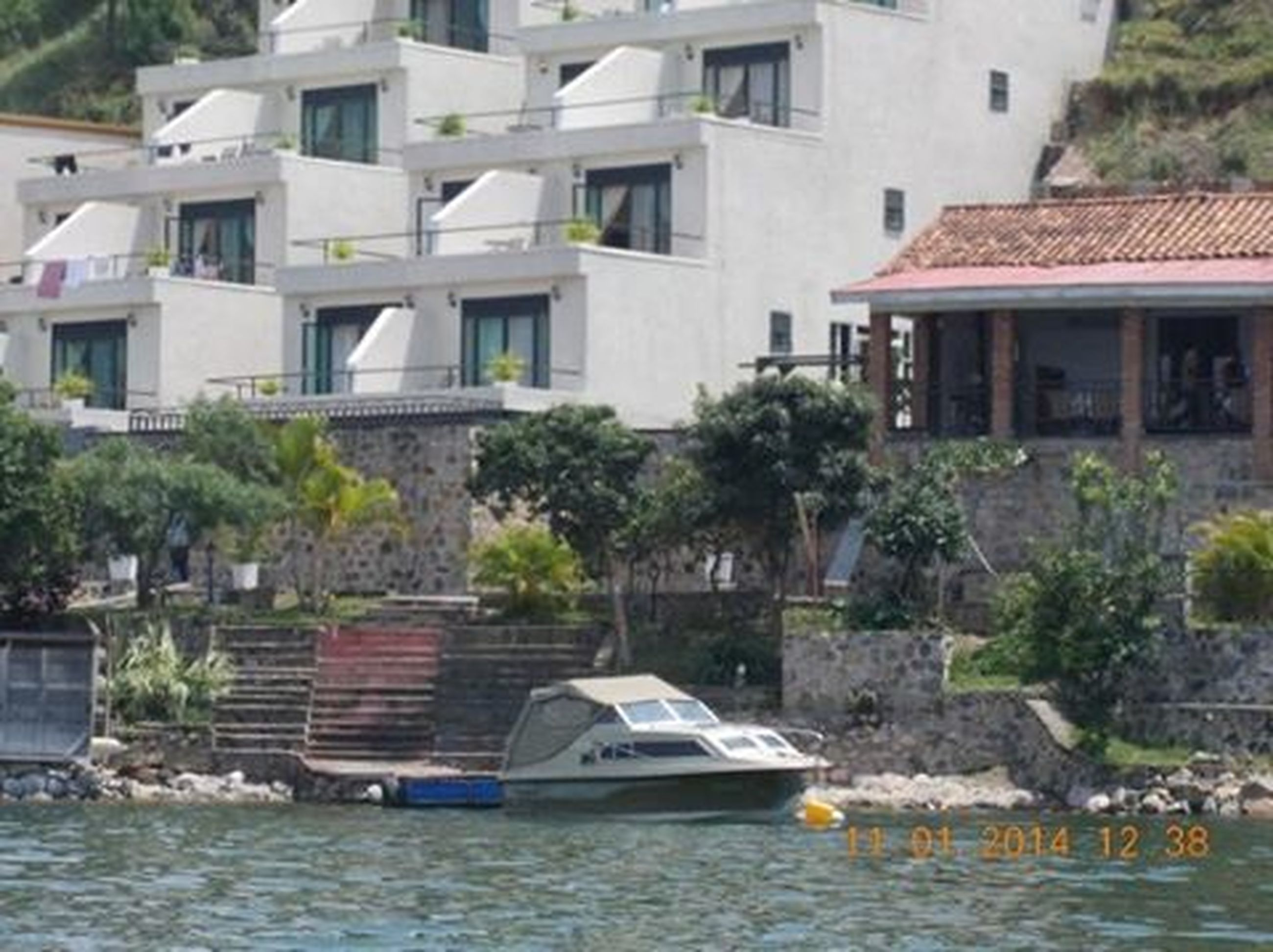architecture, built structure, water, building exterior, transportation, waterfront, nautical vessel, residential structure, house, mode of transport, boat, residential building, river, town, outdoors, canal, residential district, day, no people