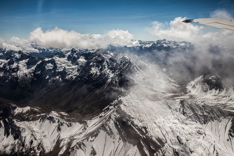 Aerial View Of Snowy Mountain Range