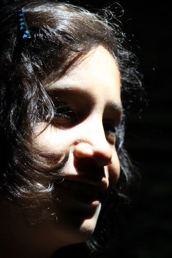 Portrait Headshot One Person Close-up Child Real People Indoors  Looking Away Human Face Innocence Black Background Black Hair Contrast Light And Shadow Half Profile EyeEmNewHere