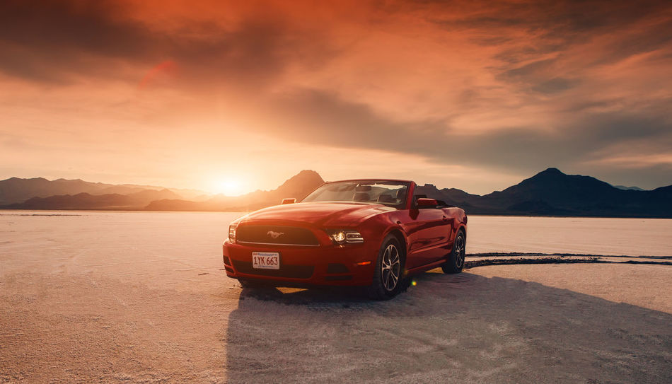 BONNEVILLE ,UTAH, USA JUNE 4, 2015: Photo of a Ford Mustang Convertible 2012 version at Bonneville Salt Flats,Utah,USA. The fifth generation began with the 2005 model year to 2014. Asphalt Bonneville Salt Flats Ford Mustang Salt Flats,Utah Bonnevillesaltflats Convertible Car Driving In My Car Mustang Convertible Outdoors Red Car Salt Flat Speed Sunset Sunset Bonneville Salt Flats Transportation