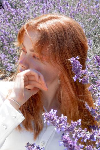 Portrait of woman with purple flowers