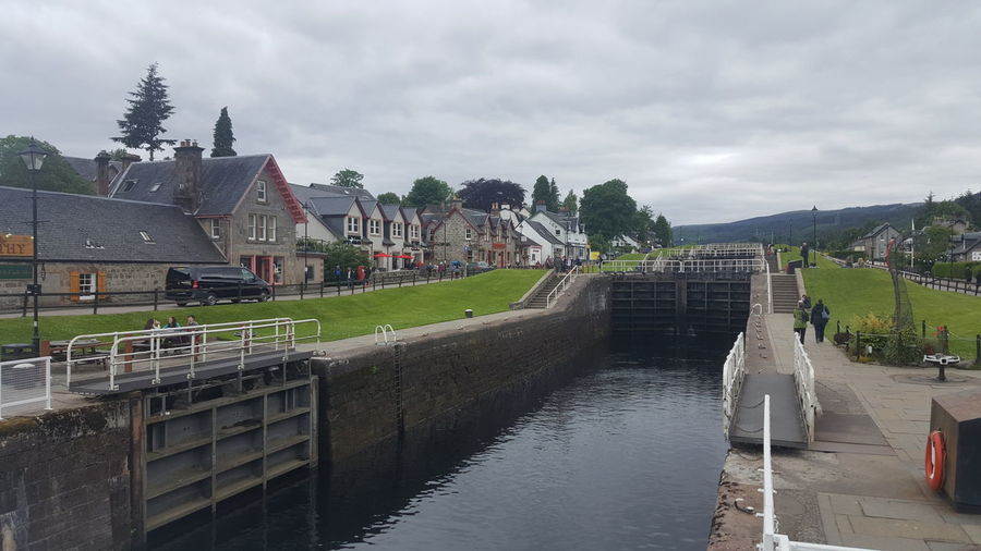 The Caledonian Canal connects the Scottish east coast at Inverness with the west coast at Corpach near Fort William in Scotland. The canal was constructed in the early nineteenth century by Scottish engineer Thomas Telford, and is a sister canal of the Göta Canal in Sweden, also constructed by Telford. 1822 Boat Boats Caledonian Canal EyeEm EyeEm Best Shots EyeEm Nature Lover Fort Augustus Fort William From My Point Of View Getting Inspired Hidden Gems  Inverness Lake Ness Loch Ness Loch Ness Monster Myth Mythology Ness Scotland Swing Bridge The Purist (no Edit, No Filter) Thomas Telford Uk United Kingdom